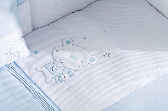 Edredon y protector de cuna en color azul osito stars